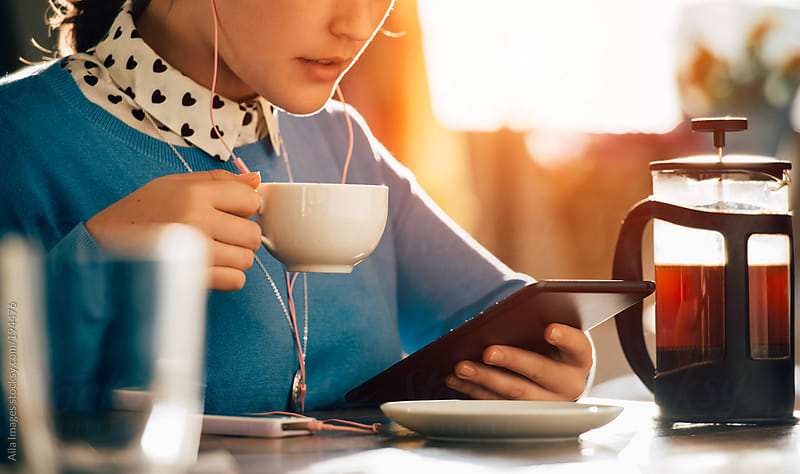 Woman using technology in cafe by Aila Images for Stocksy United