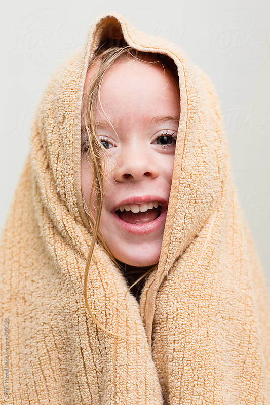 girl in a towel by Brian Powell for Stocksy United
