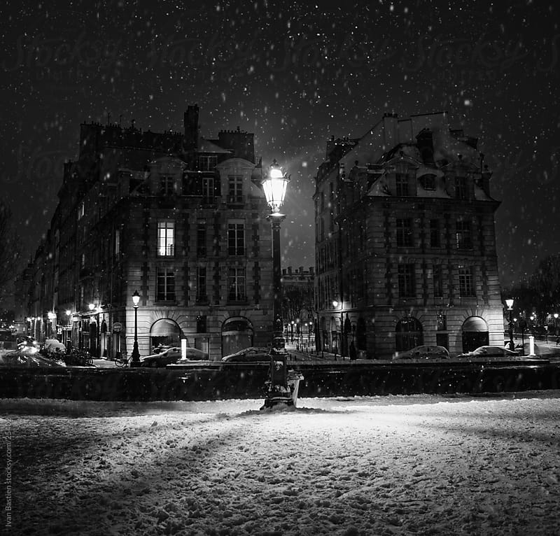 Street in Paris under snow by Ivan Bastien for Stocksy United
