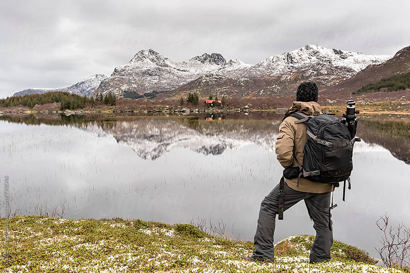 From behind: man enjoying views from Norway by Guille Faingold for Stocksy United