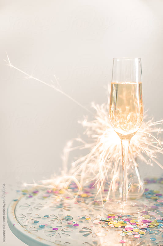Single Glass of Champagne with Sparkler by suzanne clements for Stocksy United