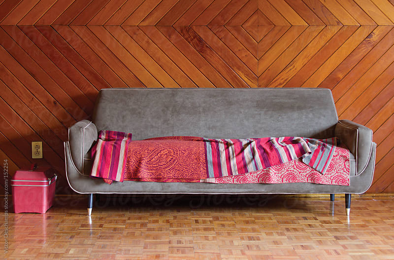 Cozy couch by Victor Deschamps for Stocksy United