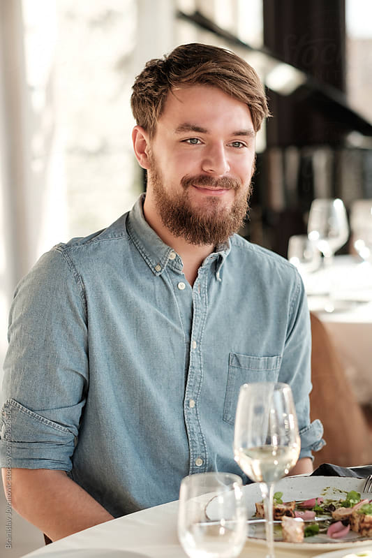 Handsome Caucasian Man Having Lunch at the Restaurant by Branislav Jovanović for Stocksy United