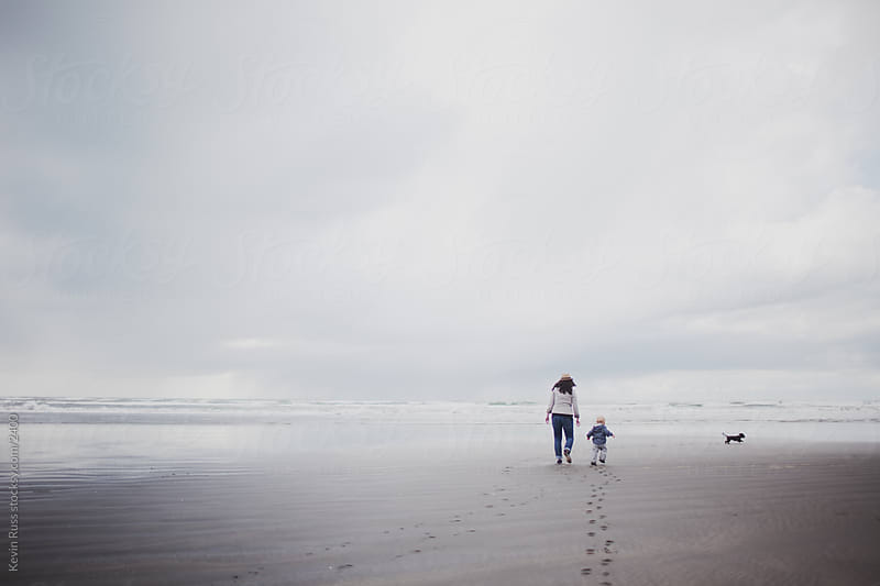 Small Family Beach Walk by Kevin Russ for Stocksy United