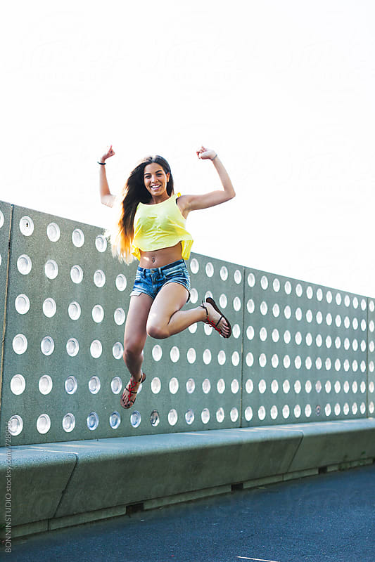 Young woman jumping in a park on summer. by BONNINSTUDIO for Stocksy United