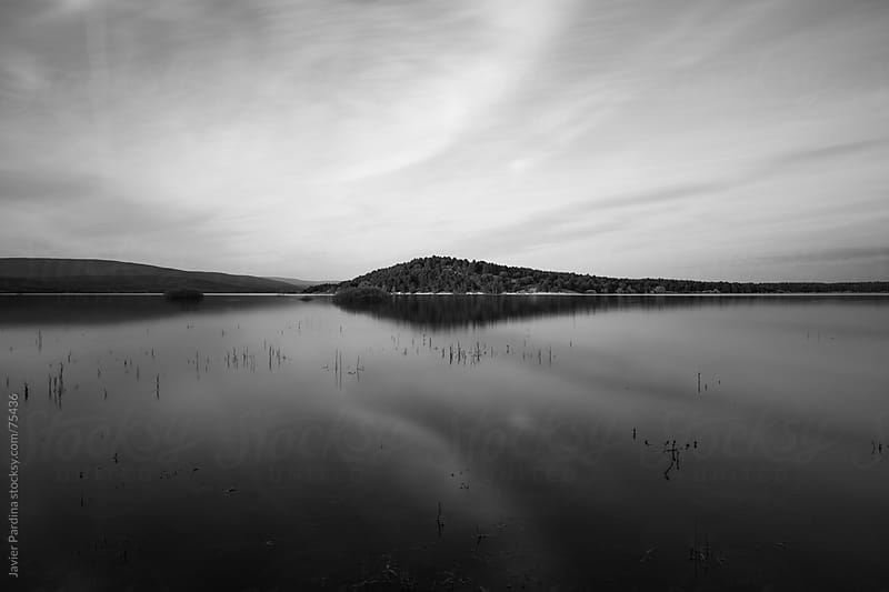 landscape with  lake in black and white by Javier Pardina for Stocksy United
