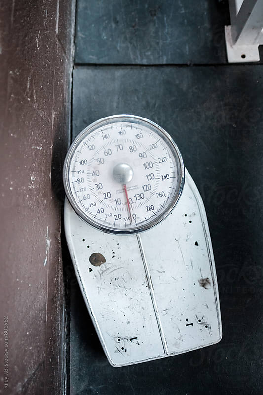An old body weight scale from above. by Riley J.B. for Stocksy United