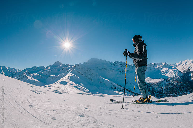 Skier on the peak mountain ready for skiing by Davide Illini for Stocksy United
