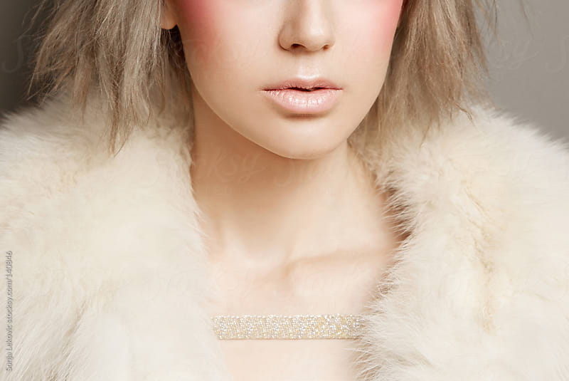 woman in fur closeup by Sonja Lekovic for Stocksy United