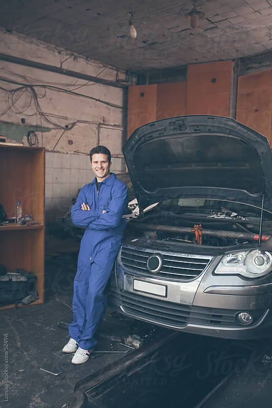 Smiling Mechanic at His Workshop by Lumina for Stocksy United