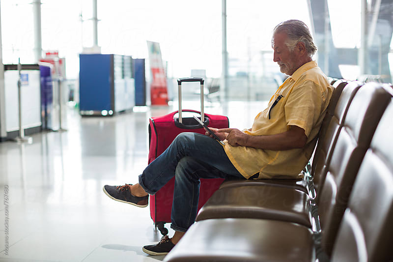 Man Waiting at the Airport Gate by Mosuno for Stocksy United