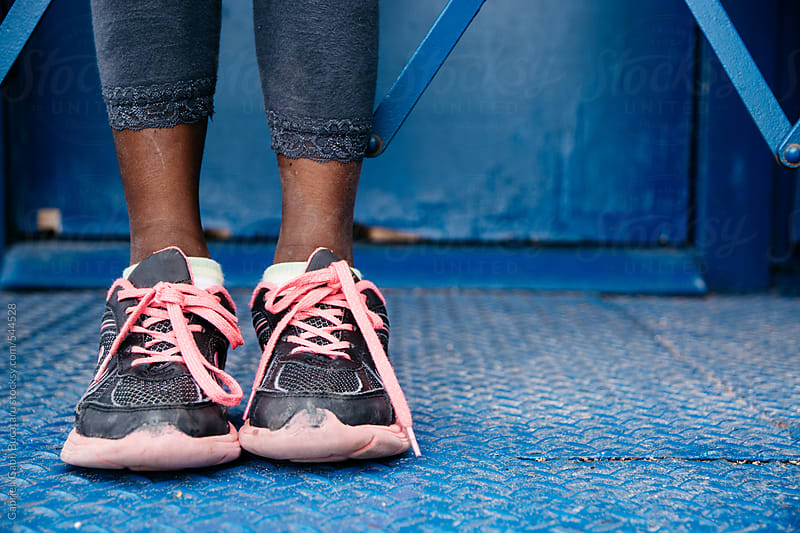 Legs with sneakers of an African American young girl by Gabriel (Gabi) Bucataru for Stocksy United
