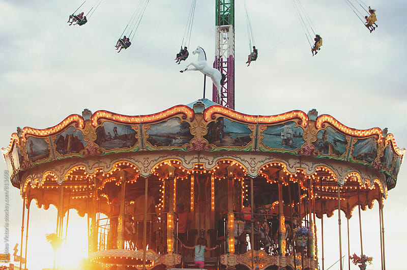A merry go round at sunset by Chelsea Victoria for Stocksy United