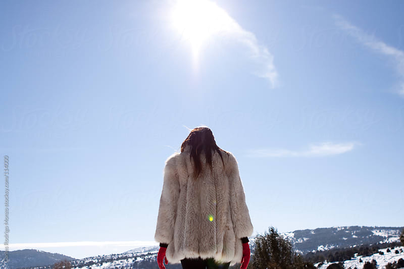 Girl with fur coat in the snow mountains. by Carles Rodrigo Monzo for Stocksy United