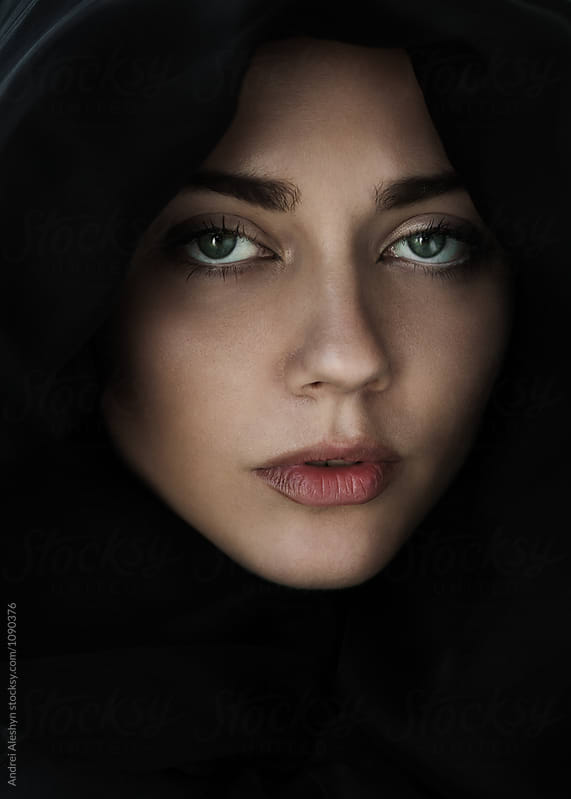 beautiful young girl in a hood closeup by Andrei Aleshyn for Stocksy United