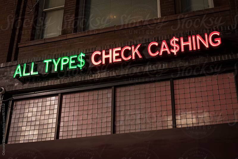 Check Cashing Neon Sign by Odyssey Stock for Stocksy United
