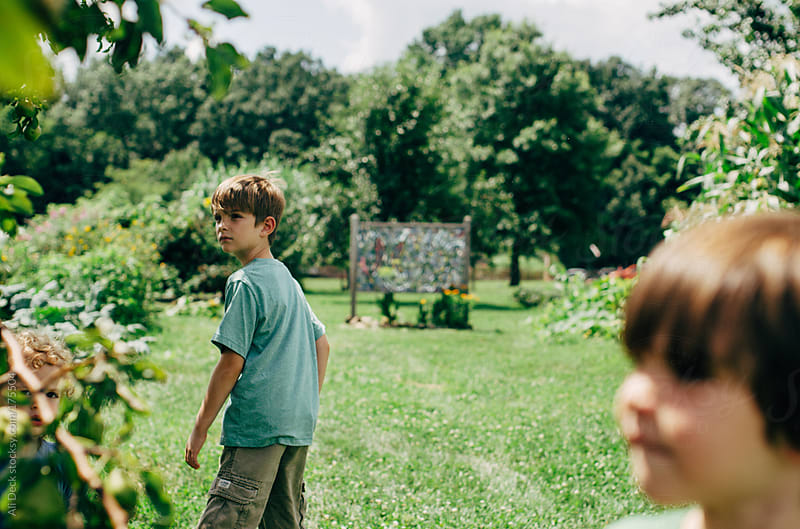 Two Young Boys on the Farm by Ali Deck for Stocksy United