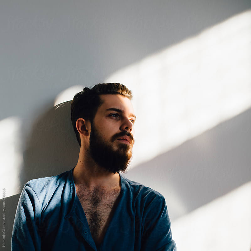 Pensive Bearded Man  by Nemanja Glumac for Stocksy United