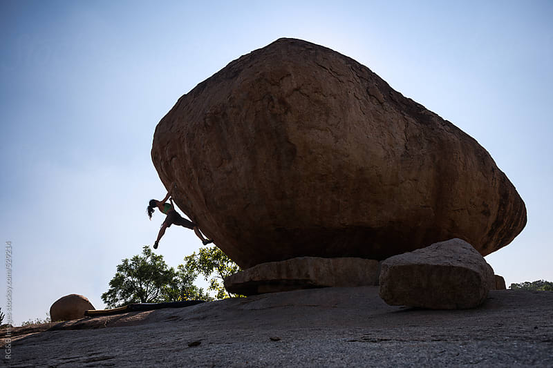 woman climbing on a huge boulder by RG&B Images for Stocksy United
