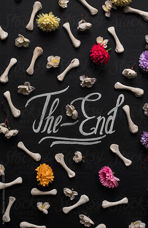 Text the end with flowers and bones by Marko Milanovic for Stocksy United