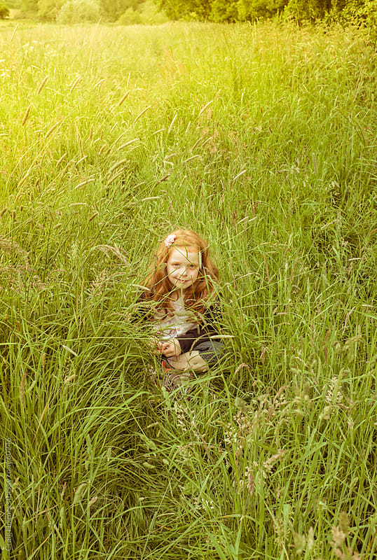 A little girl in the countryside by Craig Holmes for Stocksy United