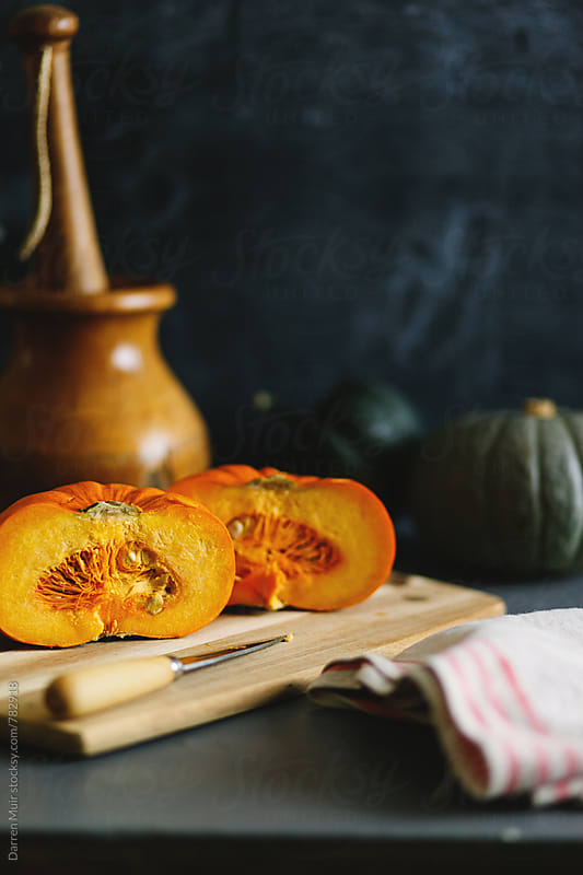 Pumpkin: Prepping pumpkin for a recipe. by Darren Muir for Stocksy United