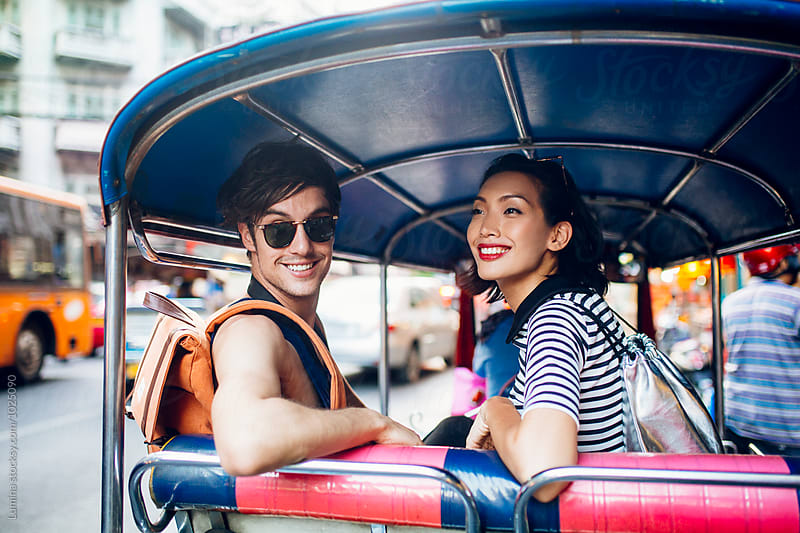 Couple Riding in a Tuk Tuk Taxi in Bangkok