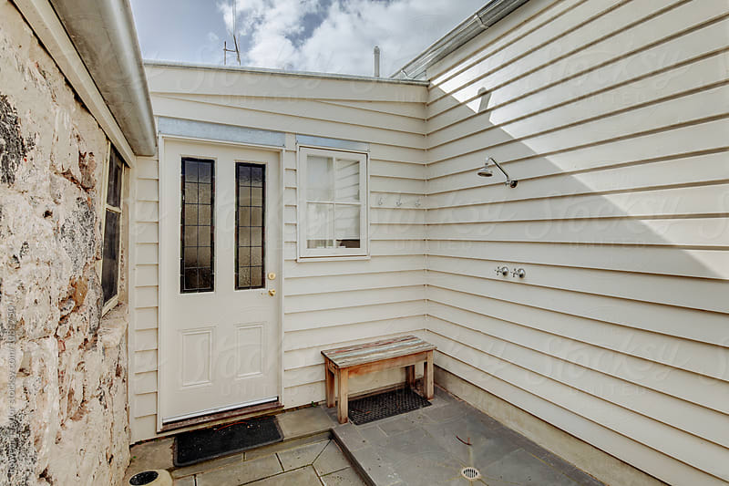 External shower area of beach cottage by Rowena Naylor for Stocksy United