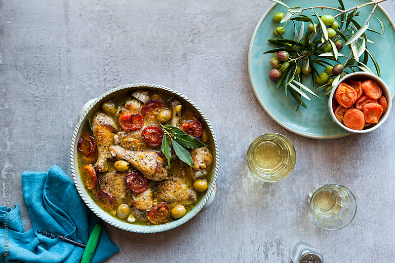 Apricot and green olive braised chicken by Nadine Greeff for Stocksy United
