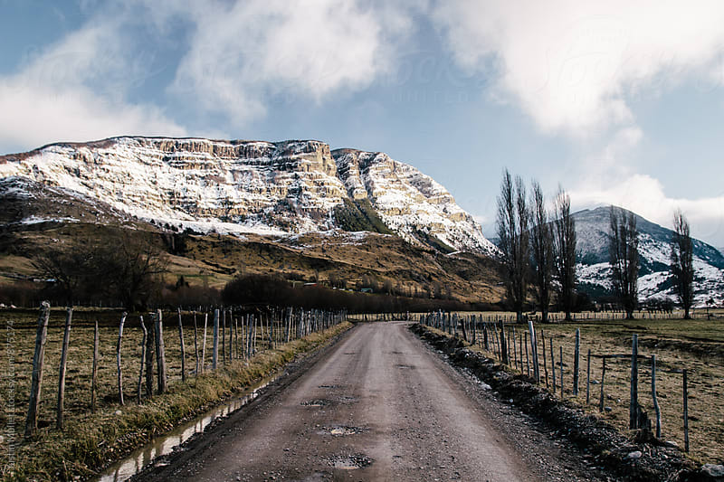 Dirt road going through rugged country in Patagonia Chile by Justin Mullet for Stocksy United