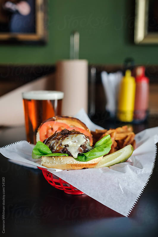 Bar Food: Cheeseburger with French Fries by Cameron Whitman for Stocksy United