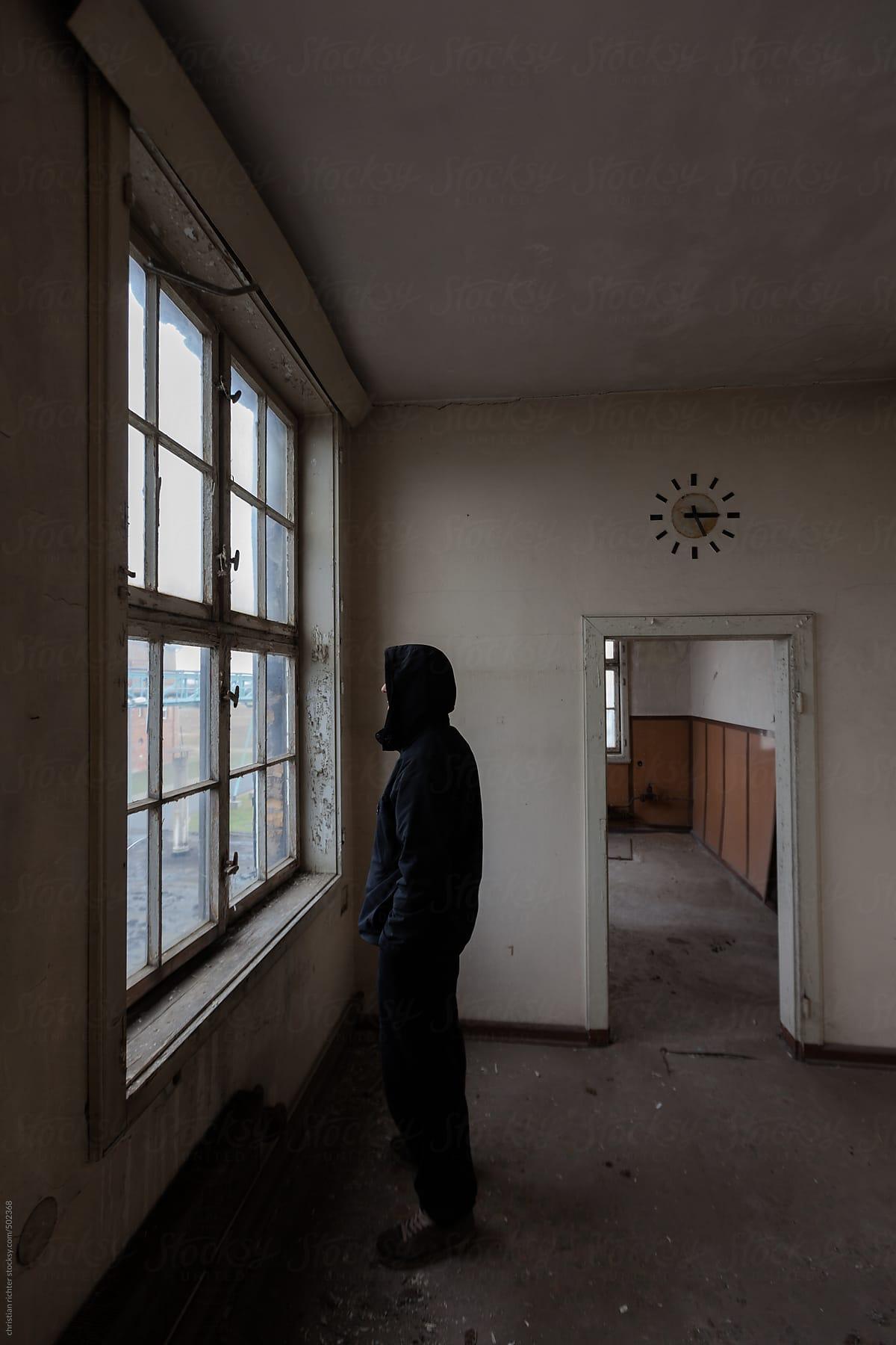 Man Looking Outside A Window Stocksy United