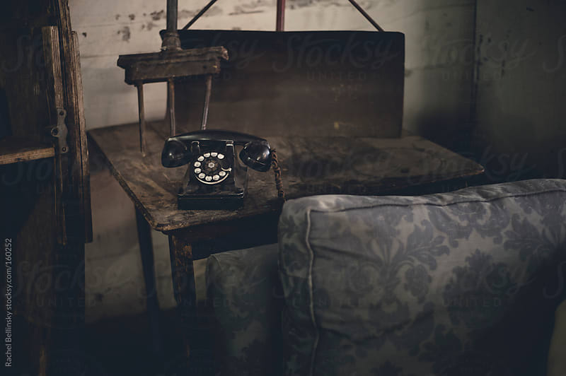 Antique room with old phone and wood furniture by Rachel Bellinsky for Stocksy United