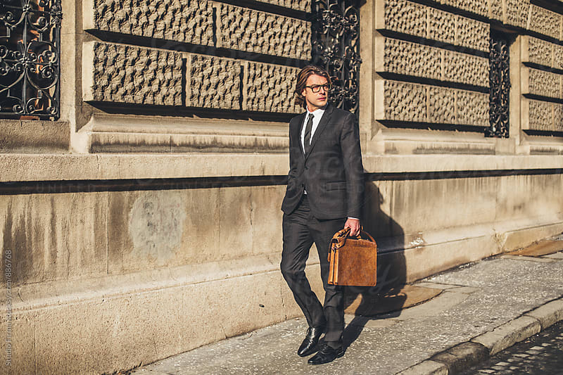 Businessman in the city. by Studio Firma for Stocksy United