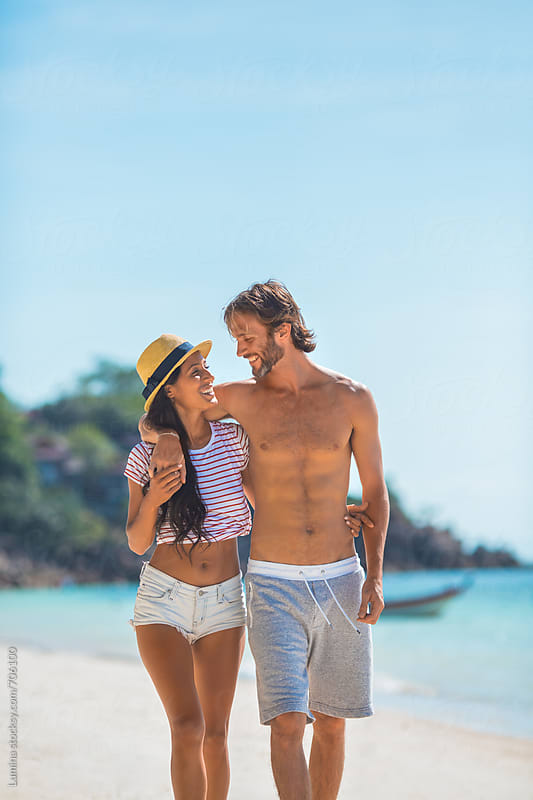 Couple Having a Walk on a Tropical Beach by Lumina for Stocksy United
