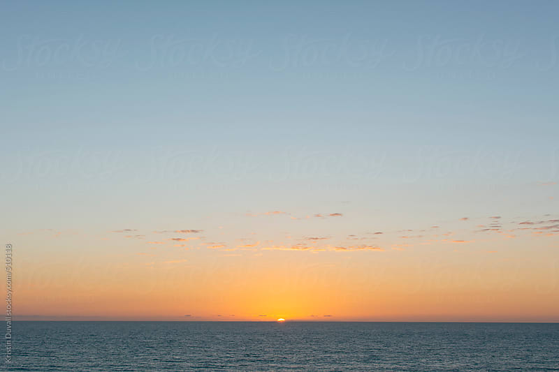 Sunset over calm ocean. California. by Kristin Duvall for Stocksy United