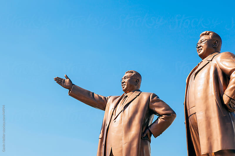 Democratic Peoples's Republic of Korea (DPRK), North Korea, Pyongyang, Mansudae Grand Monument, Statues of former Presidents Kim Il-Sung and Kim Jong Il, Mansudae Assembly Hall on Mansu Hill by Gavin Hellier for Stocksy United