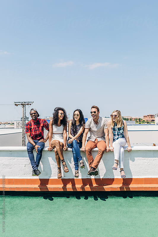 Group of Multi-Ethnic Friends Hanging out in a Rooftop