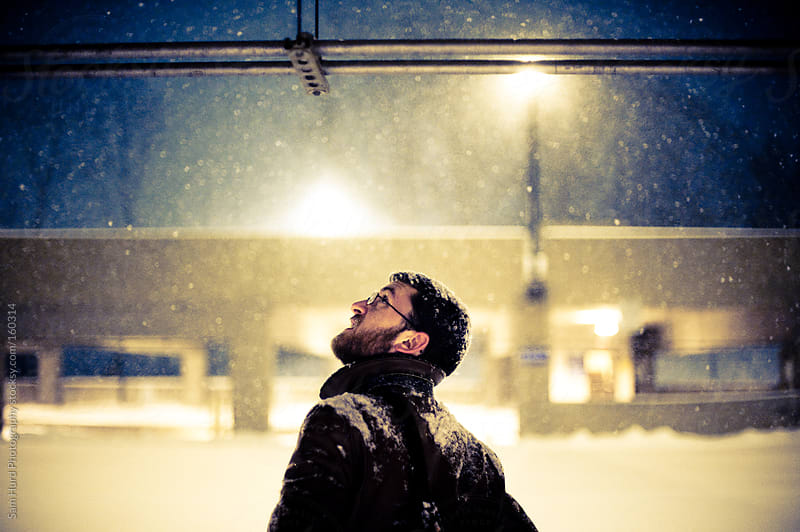 man in a snow storm by Sam Hurd Photography for Stocksy United