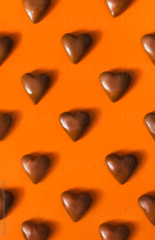 Chocolate cookie hearts on orange background by Marko Milanovic for Stocksy United