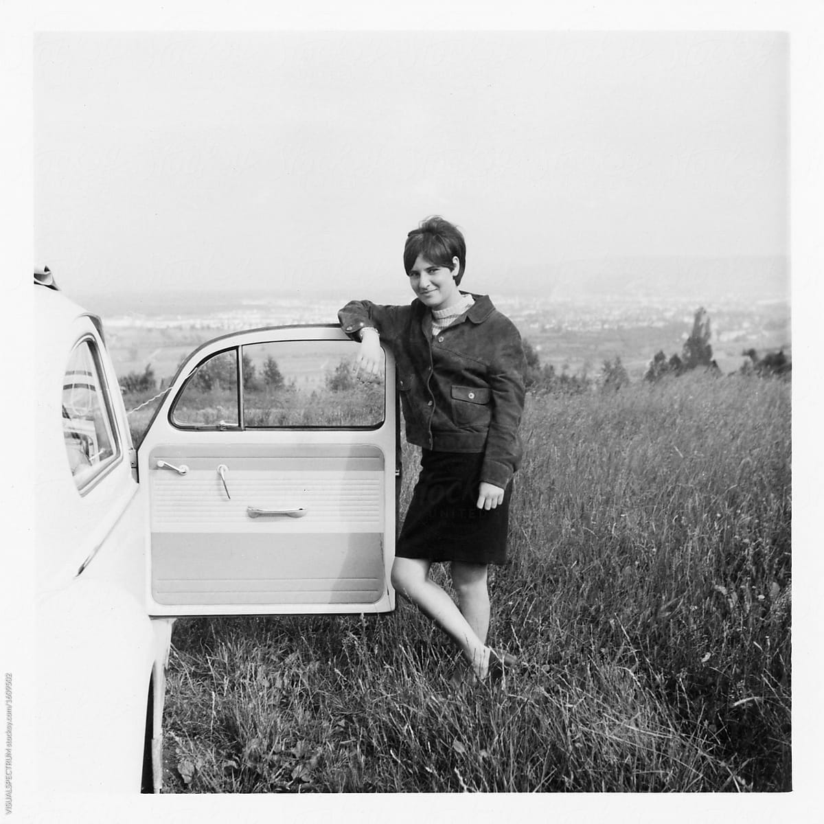 Scan of old 1960s black and white photograph of young woman stan by visualspectrum for stocksy