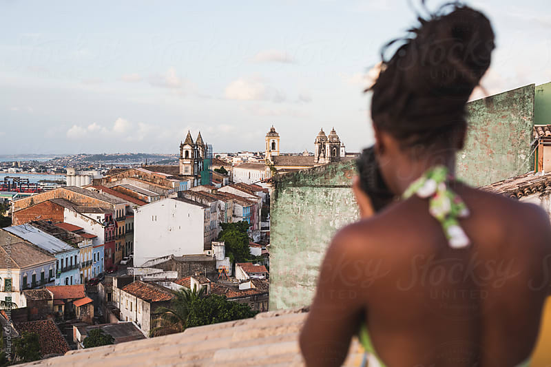 Brazil. Woman taking pictures from a view point in Salvador de Bahia by Mauro Grigollo for Stocksy United