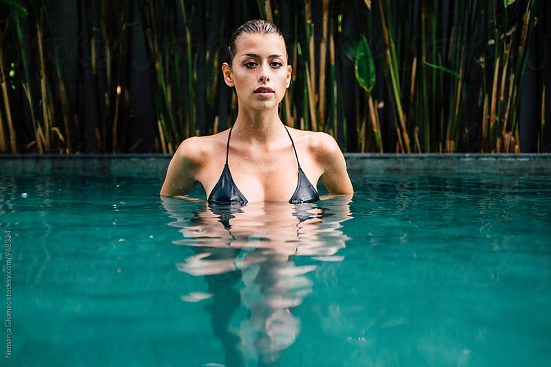 Beautiful Female Model Posing in the Pool by Nemanja Glumac for Stocksy United