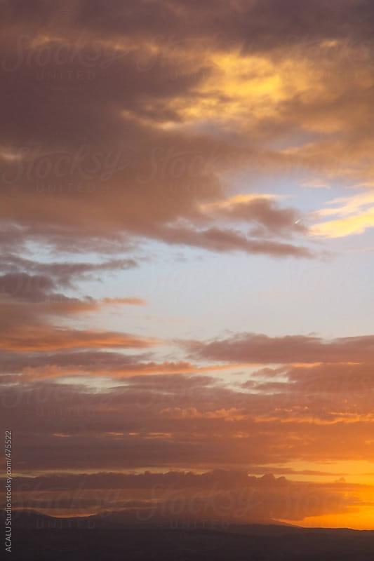 Intense orange sunset by ACALU Studio for Stocksy United