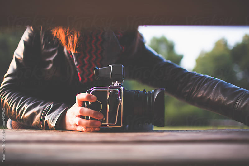 Woman with analog camera by Tommaso Tuzj for Stocksy United