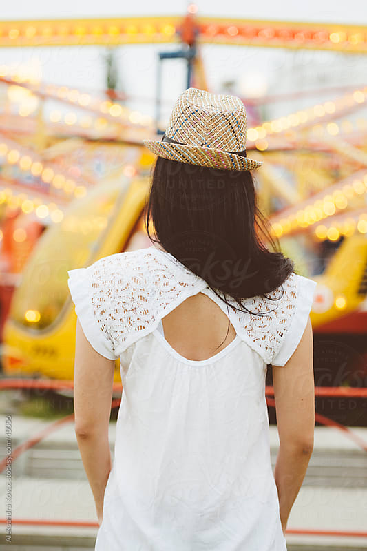 Young woman in amusement park by Aleksandra Kovac for Stocksy United