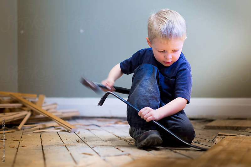 Little Boy Carpenter With Hammer and Wood by JP Danko for Stocksy United