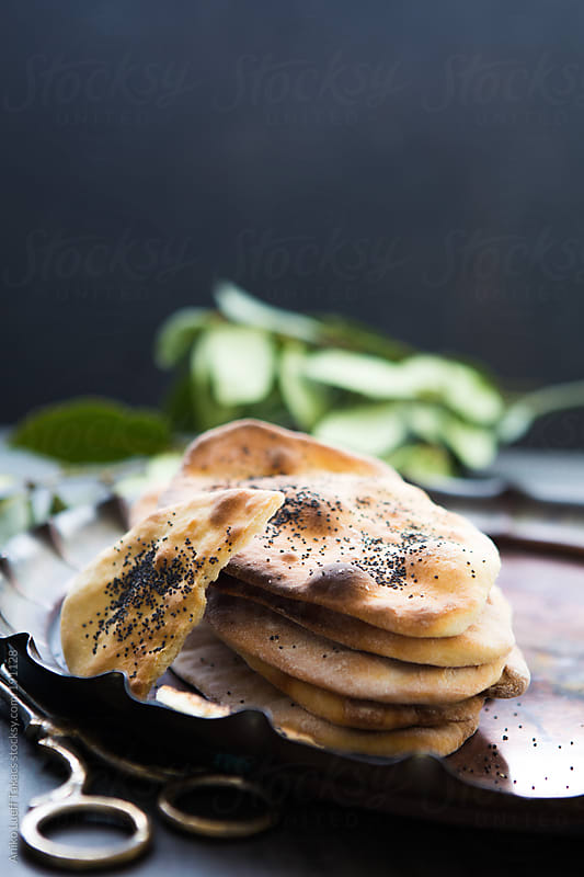 Home made Naan breads by Aniko Lueff Takacs for Stocksy United
