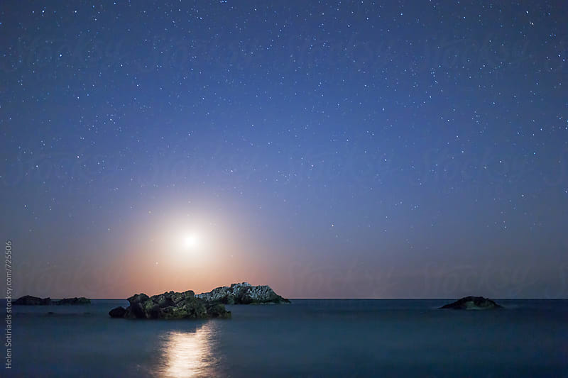 The Setting Moon over a Rocky Seascape by Helen Sotiriadis for Stocksy United