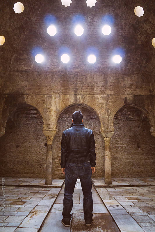 Man inside abandoned Arab baths by ACALU Studio for Stocksy United